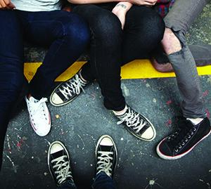 Picture for different people wearing Converse Sneakers